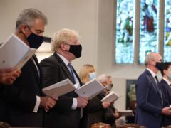 Secretary of State for Northern Ireland, Brandon Lewis (left) and Prime Minister Boris Johnson attend a service to mark the centenary of Northern Ireland at St Patrick's Cathedral in Armagh (Liam McBurney/PA)