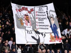 Crystal Palace fans in the stands hold up a banner criticising the new ownership of Newcastle United during the Premier League match at Selhurst Park, London. Picture date: Saturday October 23, 2021.