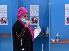 A woman casts her vote at a polling station during the presidential election in Tashkent, Uzbekistan (AP)