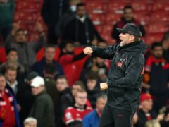 Liverpool manager Jurgen Klopp punches the air in celebration with fans at their historic 5-0 win at Manchester United (Martin Rickett/PA)