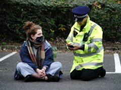 Protesters from Insulate Britain are arrested by police in the car park of the DoubleTree Hilton at Dartford Crossing (PA)