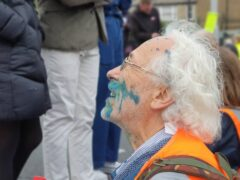Insulate Britain protesters were squirted with ink as they blocked roads (Insulate Britain/PA)