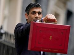 Chancellor of the Exchequer Rishi Sunak holds his ministerial 'Red Box' as he stands with his ministerial team and Parliamentary Private Secretaries, outside 11 Downing Street, London, before delivering his Budget to the House of Commons. Picture date: Wednesday October 27, 2021.