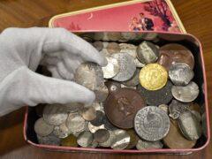 The tin of old coins (Morton & Eden/PA)