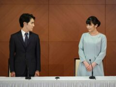 Japan's former Princess Mako and her husband Kei Komuro look at each other during a press conference to announce their marriage at a hotel in Tokyo, Japan (Nicolas Datiche/Pool Photo via AP)