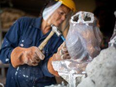 Artist Helen Wilson Roe works on her sculpture of Henrietta Lacks (John Roe/University of Bristol/PA)