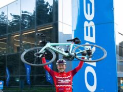 Gordon Miller celebrates at Orbea's headquarters after completing his attempt to break the world record for the greatest distance covered by an electric bicycle in seven days (James Aubry/PA)