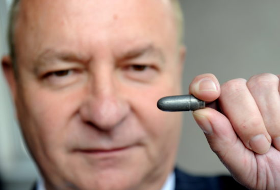 Alistair Greig's victims investigation photo of Greig with bullet