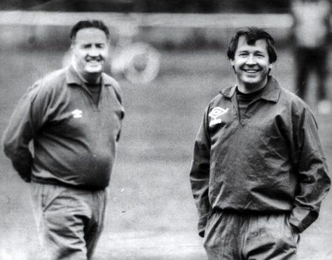The late great Jock Stein on Scotland duty alongside Sir Alex Ferguson.