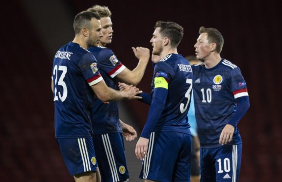 Scotland's Andy Considine, Andy Robertson and Callum McGregor (L-R) at full time after Slovakia match.