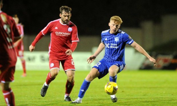 Brechin's Michael Paton up against Peterhead's Andrew McCarthy.