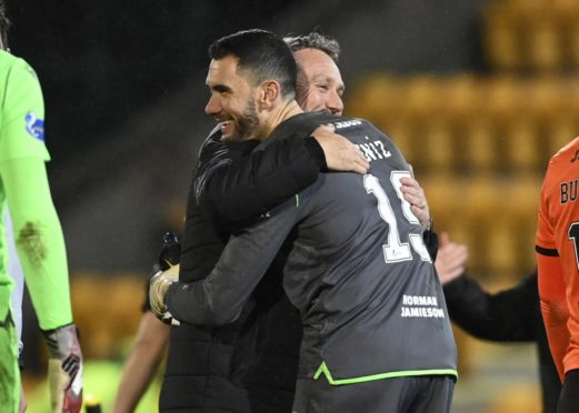 Micky Mellon and Dundee United goalie Deniz Mehmet celebrate.