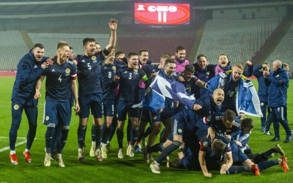 Scotland's players celebrate after David Marshall saves Aleksandar Mitrovic's penalty to send Scotland to the Euros.