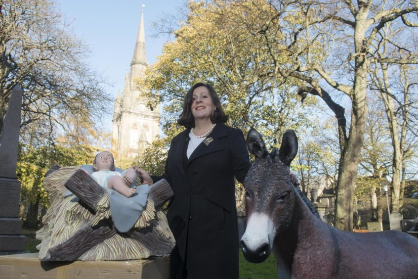 The Depute Provost of Aberdeen Jennifer Stewart with the two new additions to the city's Nativity scene.