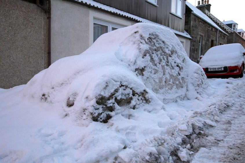 An artistic resident on Well Street, Cupar, crafted a VW Beetle out of snow and ice.