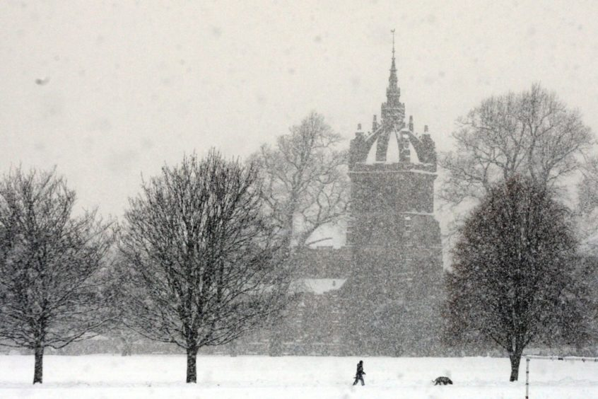 A snowy scene with St Leonard-in-the-Fields Church in the background at South Inch, Perth.