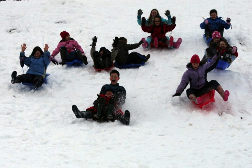 It wasn't all bad..Children having fun sledging at the North Inch, Perth, thanks to the snow.