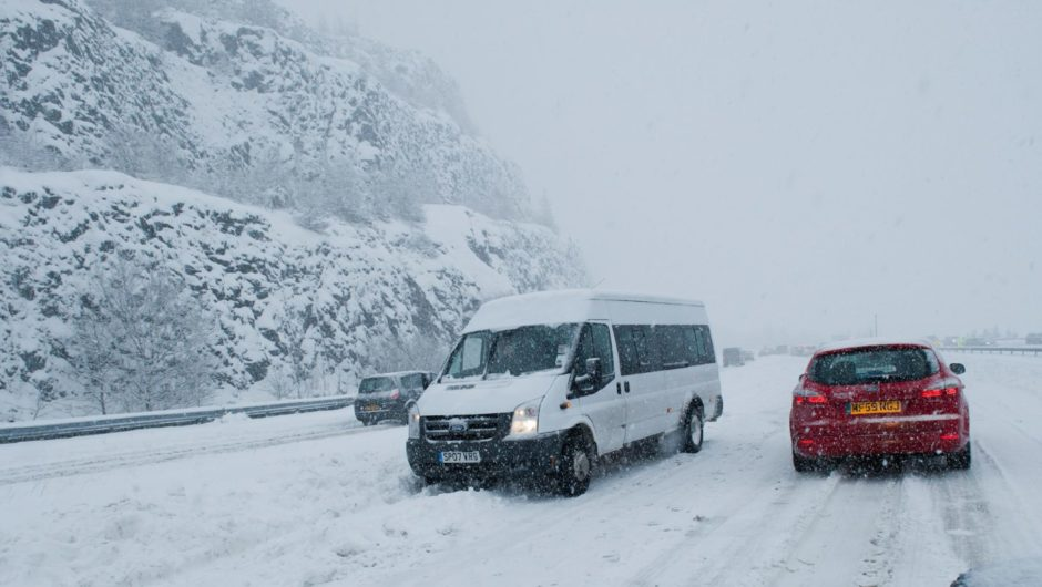 A minibus stuck in snow facing oncoming traffic on the M90 between Perth and Bridge of Earn.