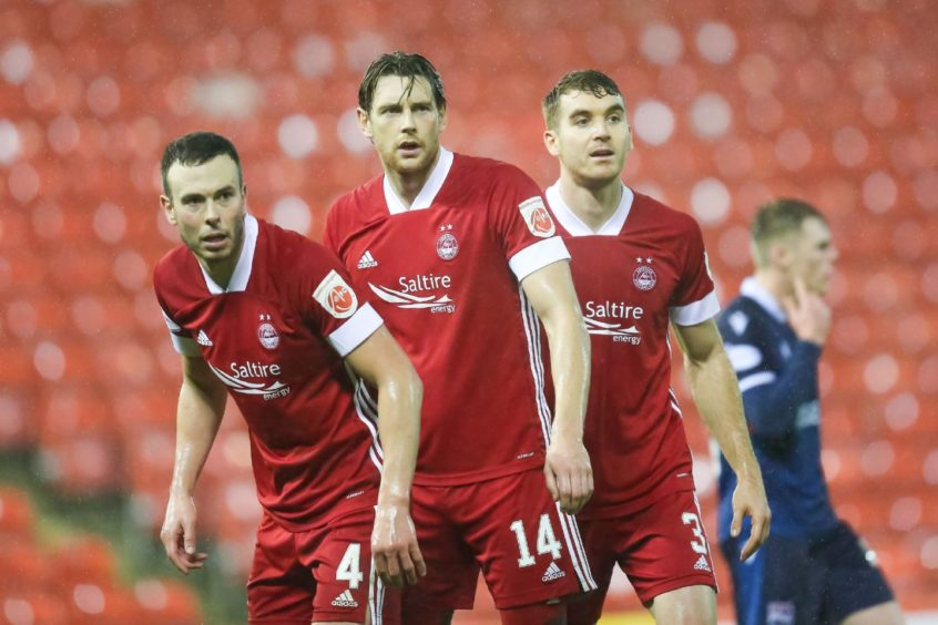 Left to right, Aberdeen defenders Andrew Considine, Ashton Taylor and Tommie Hoban.
