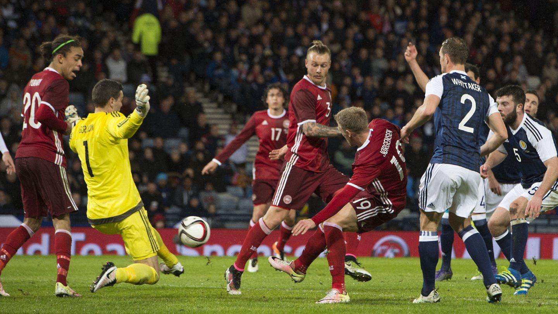 Scotland's Craig Gordon makes the save from Denmark's Nicolai Jorgensen in 2016.