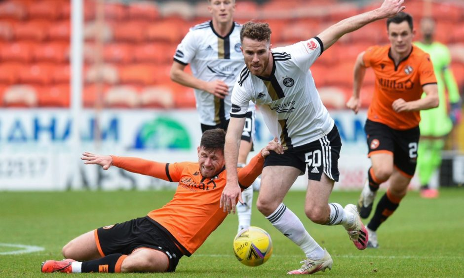 Aberdeen's Marley Watkins and Dundee United's Calum Butcher tangle.