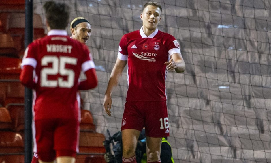 Aberdeen's Sam Cosgrove celebrates after scoring to make it 2-0 during the Scottish Premiership match between Aberdeen and Hibernian at Pittodrie Stadium on November 6.