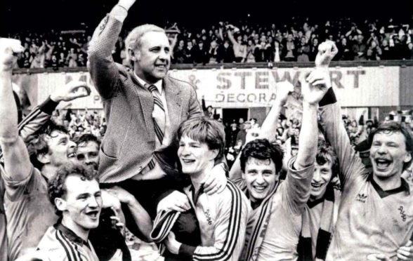 Jim McLean held aloft by his Dundee United players after winning title at Dens Park.