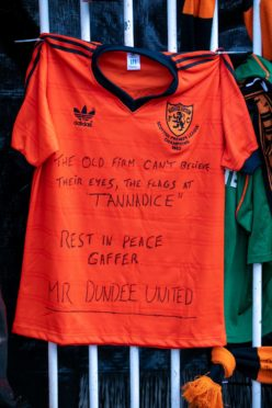 Dundee United fans pay tribute to Jim McLean outside Tannadice.