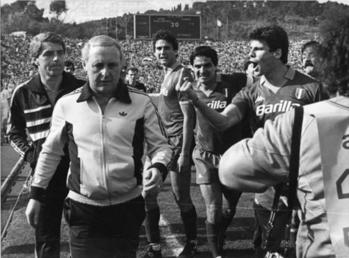 Roma players abuse Jim McLean at full-time after Dundee United are knocked out.