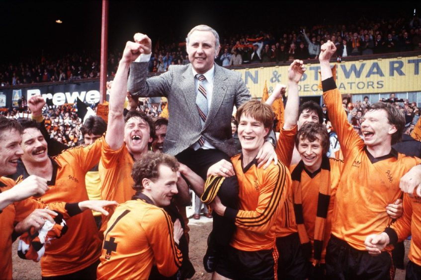 Jim McLean is held aloft by his players after United's title triumph at Dens Park.