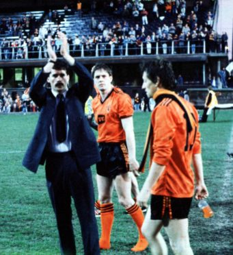 Dundee United players, John Holt (left), Billy Kirkwood and Paul Sturrock (right), applaud their fans after the end of Uefa Cup final second leg.