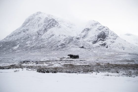 Fresh snow covers Buachaille Etive Mor in Glencoe on Sunday, December 27, 2020.