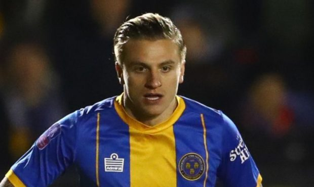 Jason Cummings in action for Shrewsbury against Liverpool.