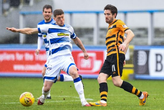 Jim McAlister in action for Morton against Alloa in February 2020.