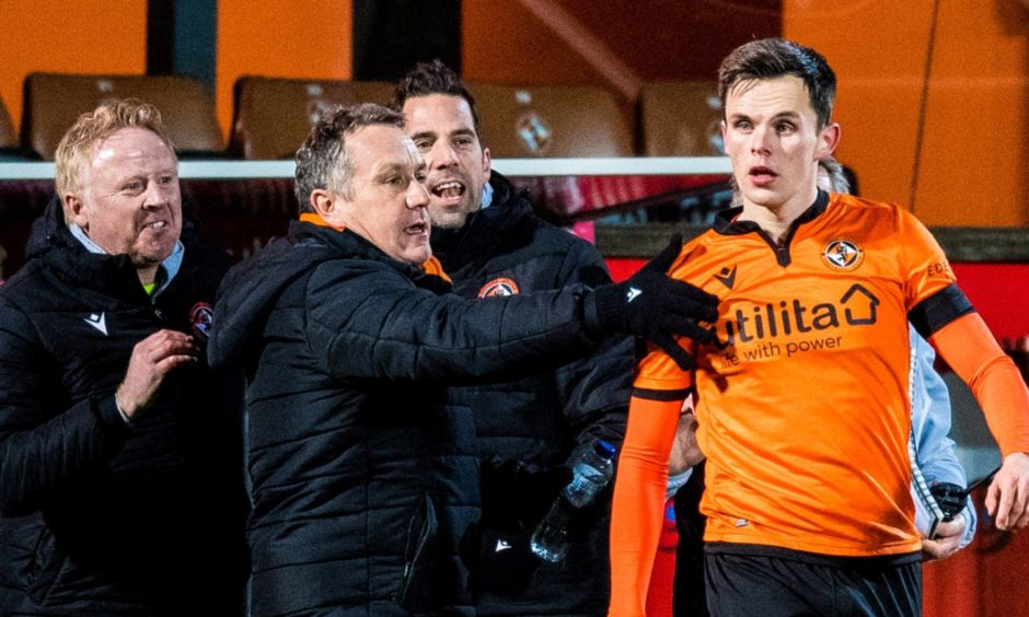 Lawrence Shankland celebrates with Dundee United boss Micky Mellon.