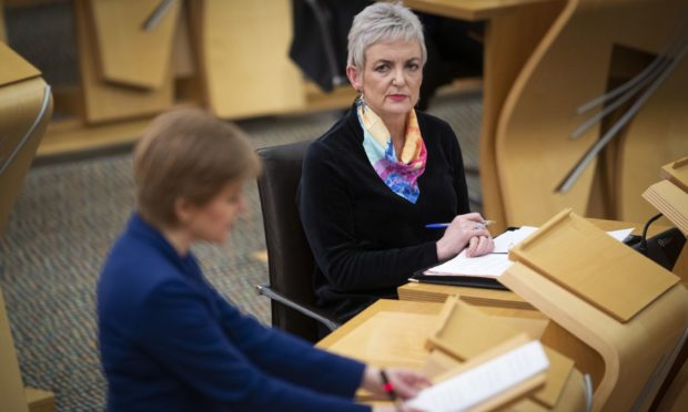 Nicola Sturgeon in the Scottish Parliament alongside Angela Constance discussing the Scotland drug laws
