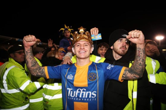 Jason Cummings at full-time as Shrewsbury fans invade the pitch after FA Cup fourth round match against Liverpool.