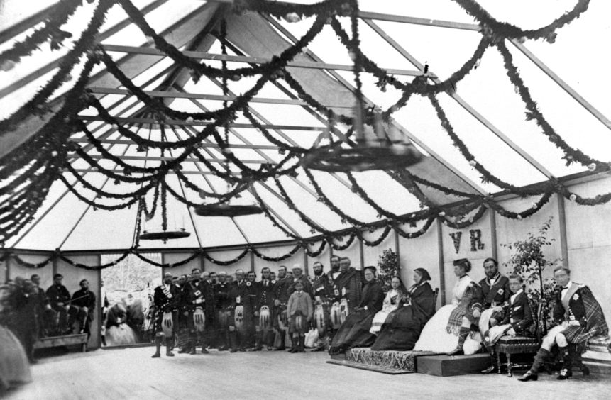 Queen Victoria at Balmoral pictured with some of her children, ladies in waiting, guests and estate staff at a celebration in a marquee in the grounds.