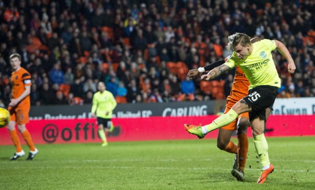 Jason Cummings scores against Dundee United.