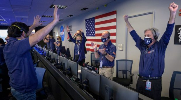 Members of Nasa's Perseverance rover team react in mission control after receiving confirmation the spacecraft successfully touched down on Mars.