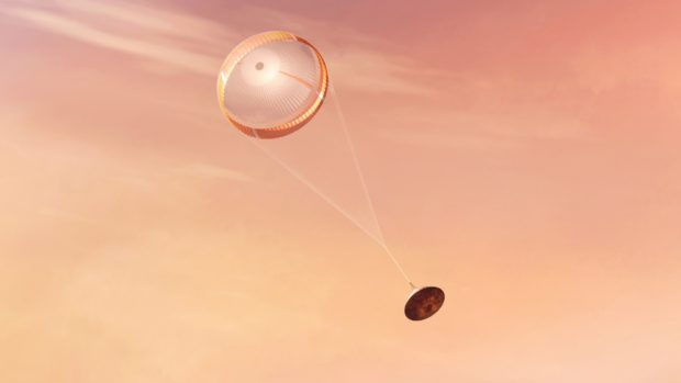 An illustration of NASA's Perseverance rover deploying a supersonic parachute from its aeroshell as it slows down before landing.