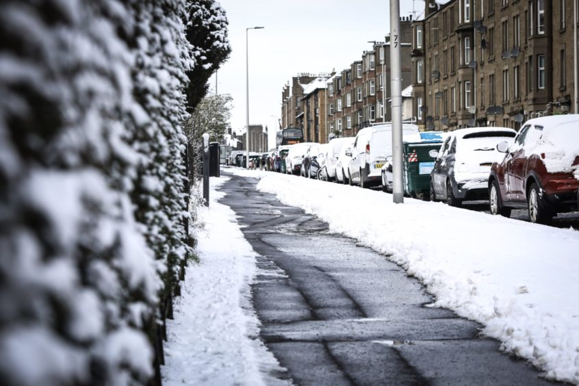 A path cleared on Clepington Road as snow hit on Monday, February 1.