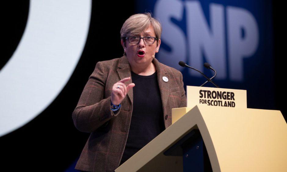 Joanna Cherry speaking at an SNP podium
