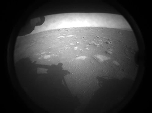 The first image Nasa's Perseverance rover sent back after touching down on Mars on Thursday.