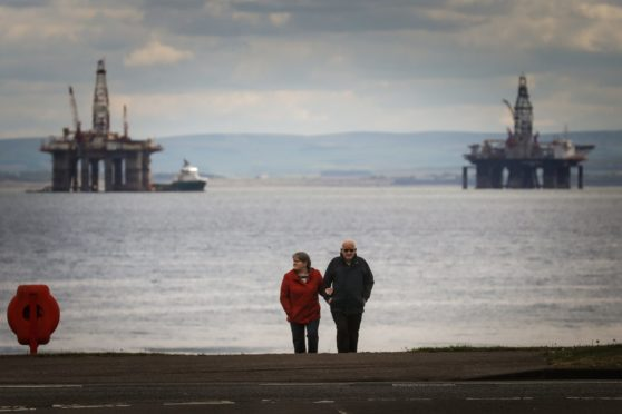 People walk on the sea front for their exercise during lockdown 2 in Leven.