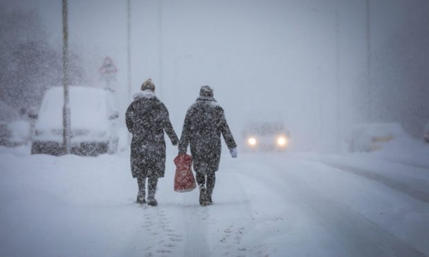 Walkers brave a blizzard on Charleston Drive, Dundee.