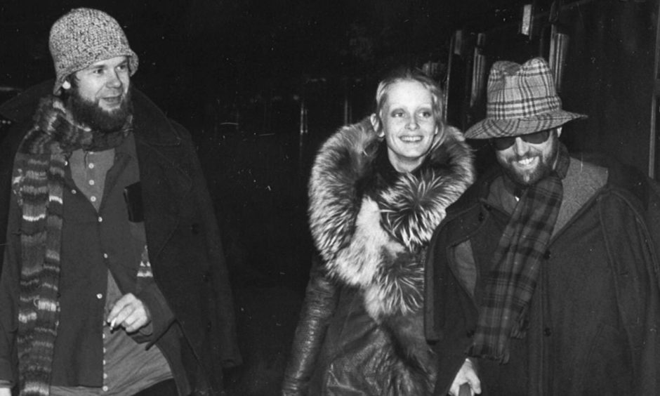 Bill Gibb, Twiggy and Justin De Villeneuve arriving at Aberdeen Station in the 1970s.