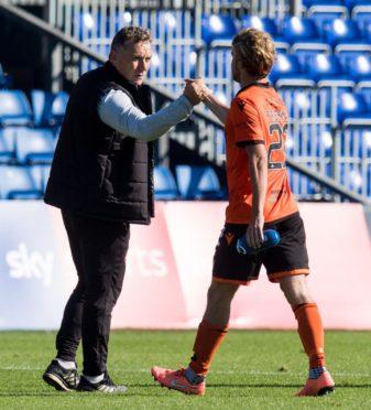 Dundee United boss Micky Mellon embraces Kieran Freeman.