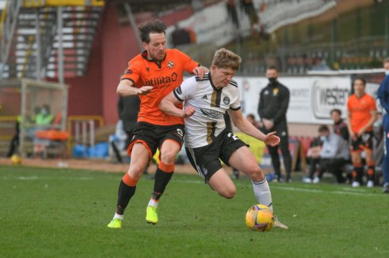 Dundee United's Marc McNulty and Aberdeen's Jack MacKenzie in action.