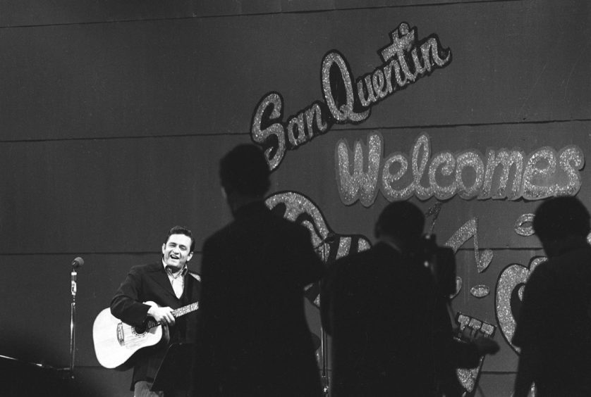 Johnny Cash performing at San Quentin during one of his famous concerts.